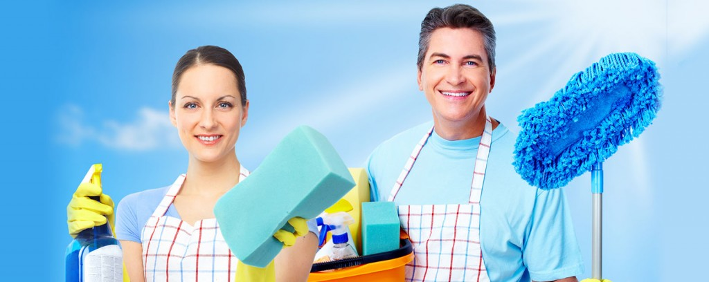 Professional cleaners team. Over blue background.